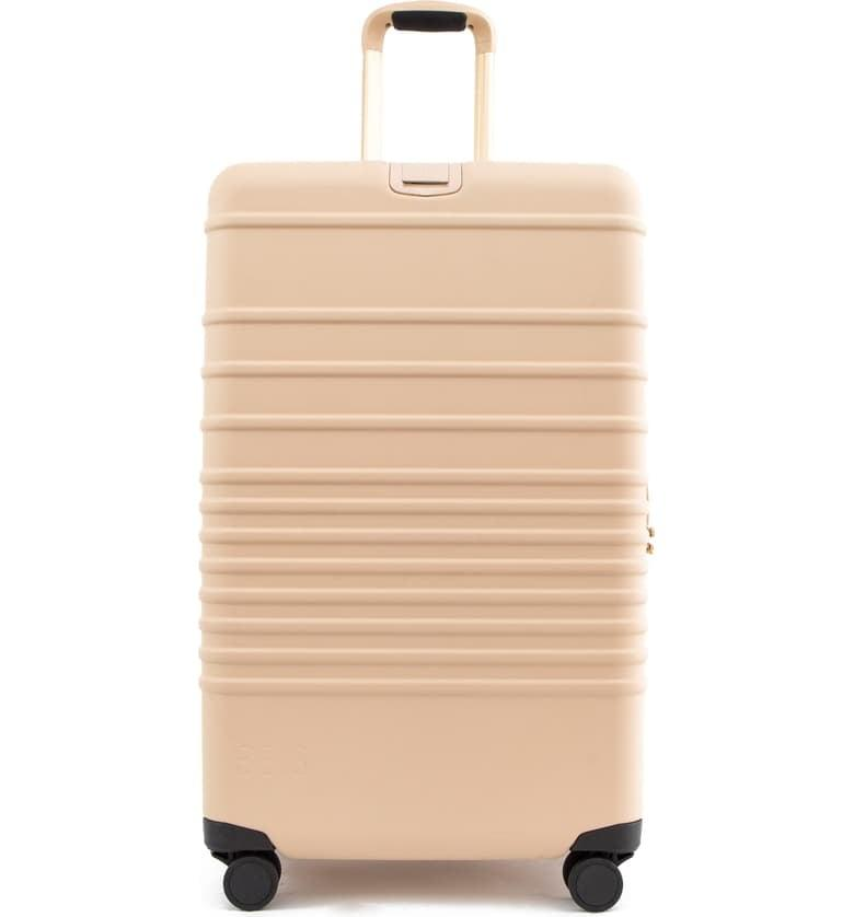 """<p>This <a href=""""https://www.popsugar.com/buy/B%C3%A9-21-Inch-Rolling-Spinner-Suitcase-538699?p_name=B%C3%A9is%2021-Inch%20Rolling%20Spinner%20Suitcase&retailer=shop.nordstrom.com&pid=538699&price=198&evar1=travel%3Aus&evar9=47133327&evar98=https%3A%2F%2Fwww.popsugar.com%2Ftravel%2Fphoto-gallery%2F47133327%2Fimage%2F47133330%2FB%C3%A9is-21-Inch-Rolling-Spinner-Suitcase&list1=shopping%2Ctravel%2Cluggage%2Csuitcases%2Ctravel%20style%2Cshay%20mitchell%2Cb%C3%A9is&prop13=api&pdata=1"""" rel=""""nofollow"""" data-shoppable-link=""""1"""" target=""""_blank"""" class=""""ga-track"""" data-ga-category=""""Related"""" data-ga-label=""""https://shop.nordstrom.com/s/beis-21-inch-rolling-spinner-suitcase/5318785/full?origin=keywordsearch-personalizedsort&amp;breadcrumb=Home%2FAll%20Results&amp;color=black"""" data-ga-action=""""In-Line Links"""">Béis 21-Inch Rolling Spinner Suitcase</a> ($198) is the perfect carry-on bag. It's sturdy, and has so many compartments!</p>"""