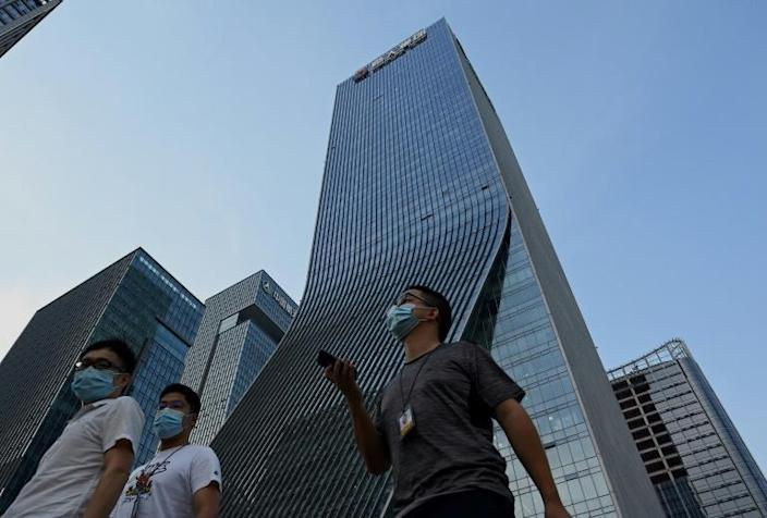 """People protested outside the Evergrande headquarters in Shenzhen, China as the property giant said it is facing """"unprecedented difficulties"""" (AFP/Noel Celis)"""