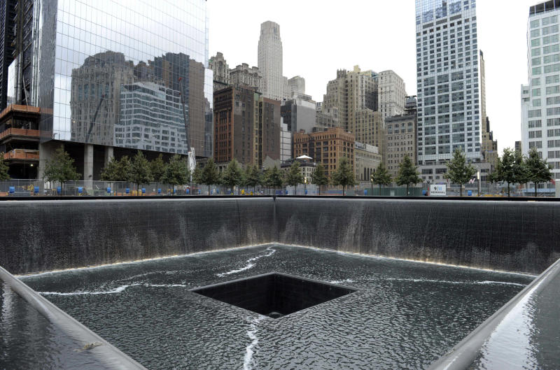 FILE - In this Sept. 6, 2011 file photo, the World Trade Center North Tower memorial pool at the National September 11 Memorial and Museum is seen against the New York City skyline. The foundation that runs the memorial estimates that once the roughly $700 million project is complete, it will cost $60 million a year to operate. (AP Photo/Susan Walsh, Pool, File)