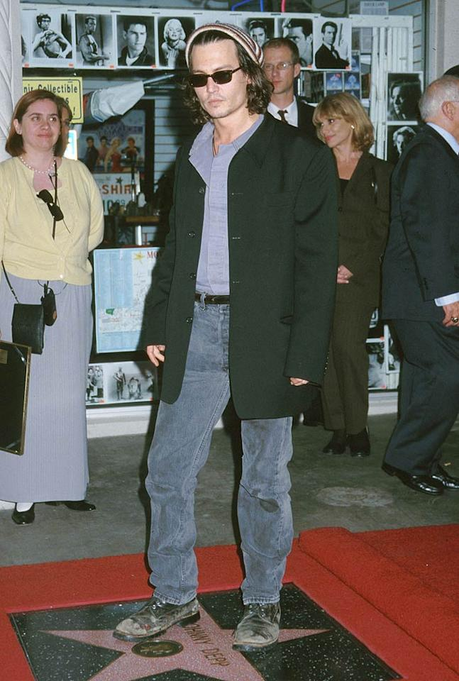 """Let's be honest, Johnny Depp has kinda always embraced the grunge look. In fact, he still does to this day. But back in the '90s -- when he received his star on the Hollywood Walk of Fame -- the eccentric actor showed up in a surprisingly casual look, which consisted of an extra large coat, jacked up jeans, busted boots, a striped skull cap, and some stubble. Jeff Vespa/<a href=""""http://www.wireimage.com"""" target=""""new"""">WireImage.com</a> - November 16, 1999"""