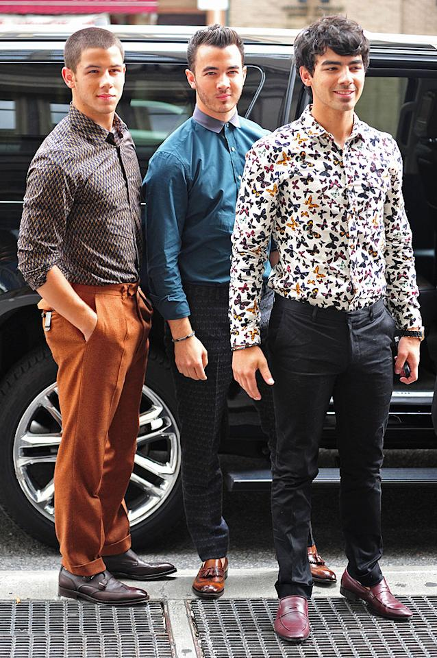 """Also spotted in unsettling outfits this week were the <a target=""""_blank"""" href=""""http://omg.yahoo.com/news/jonas-brothers-stage-comeback-one-night-only-concert-191500565.html"""">Jonas Brothers</a>: Nick, Kevin, and Joe, who caused a commotion in NYC upon arriving at a TV taping. Which one of their looks is lousiest? We're leaning towards Joe's getup, which featured a butterfly-covered blouse and red loafers. (8/20/2012)<br><br><a target=""""_blank"""" href=""""http://bit.ly/lifeontheMlist"""">Follow What Were They Thinking?! creator, Matt Whitfield, on Twitter!</a>"""