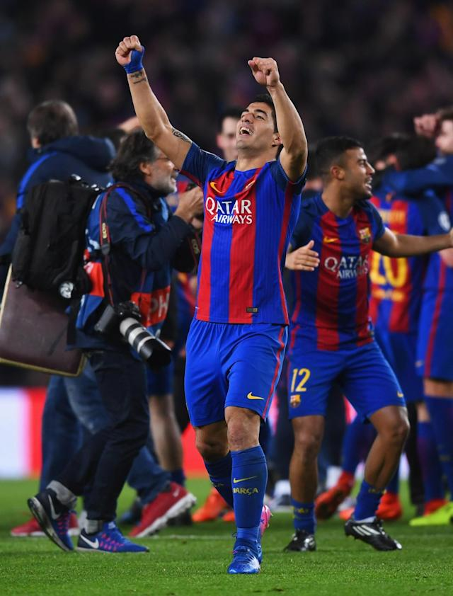 <p>Luis Suarez of Barcelona celebrates victory after the UEFA Champions League Round of 16 second leg match between FC Barcelona and Paris Saint-Germain at Camp Nou on March 8, 2017 in Barcelona, Spain. Barcelona won by 6 goals to one to win 6-5 on aggregate. (Photo by Michael Regan/Getty Images) </p>