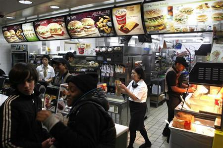 Customers are served at a Macdonald's fast food restaurant in London