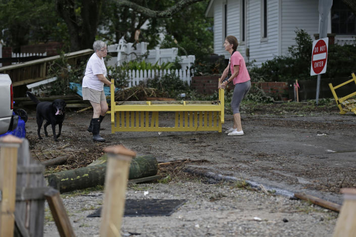 Residents begin to clean up following the effects of Hurricane Isaias in Southport, N.C., Tuesday, Aug. 4, 2020. (AP Photo/Gerry Broome)
