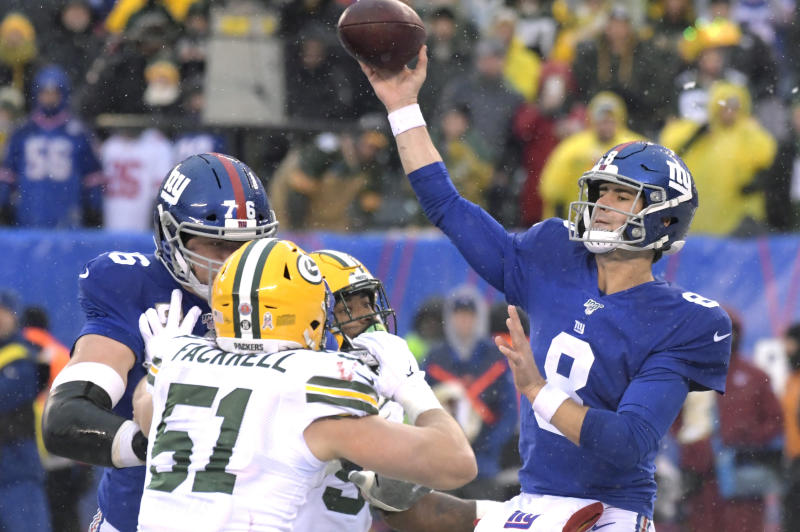 File-This Dec. 1, 2019, file photo shows New York Giants quarterback Daniel Jones (8) throwing a pass during the first half of an NFL football game against the Green Bay Packers, in East Rutherford, N.J. Jones seemingly is returning as the New York Giants starting quarterback after missing two games with a sprained right ankle. Jones took most of the first-team snaps at practice Wednesday, an major indication the rookie will start on Sunday in the penultimate game of the season against the Washington Redskins (3-11) . (AP Photo/Bill Kostroun, File)