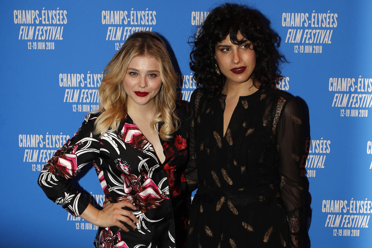 """Actress Chloe Grace Moretz, left, and director Desiree Akhavan pose during a photocall for the screening of """"Come as You Are"""" as part of the Champs Elysees Film Festival in Paris, France, Monday, June 18, 2018. (AP Photo/Francois Mori)"""