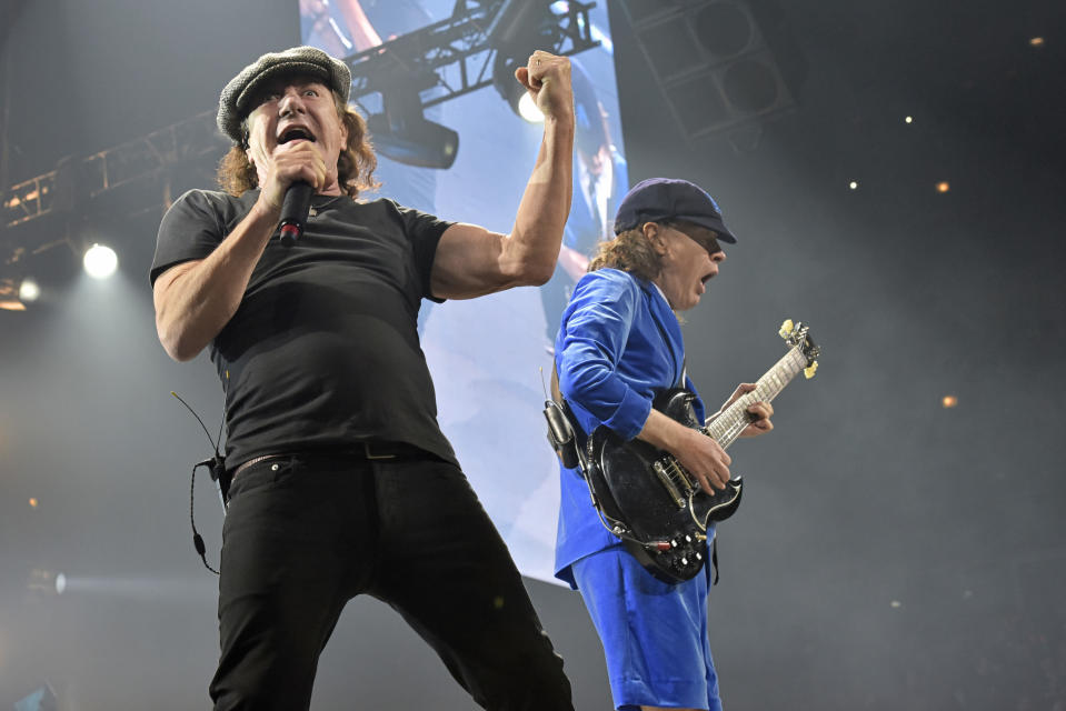 "FILE - Brian Johnson, left, and Angus Young, of AC/DC, perform on the Rock or Bust Tour on Feb. 17, 2016, in Chicago. After 47 years, the band is releasing its 17th studio album, ""Power Up,"" on Friday. (Photo by Rob Grabowski/Invision/AP, File)"