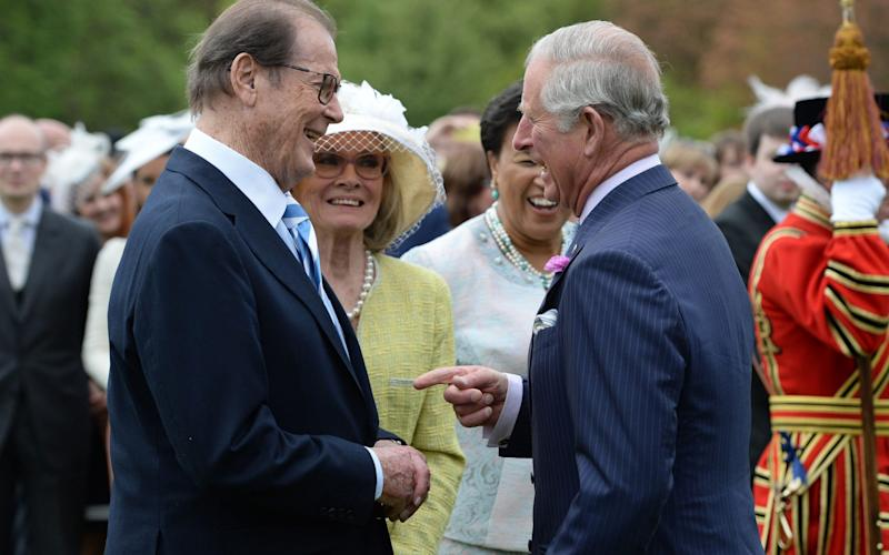 Roger Moore with Prince Charles - Credit:  Getty Images Europe
