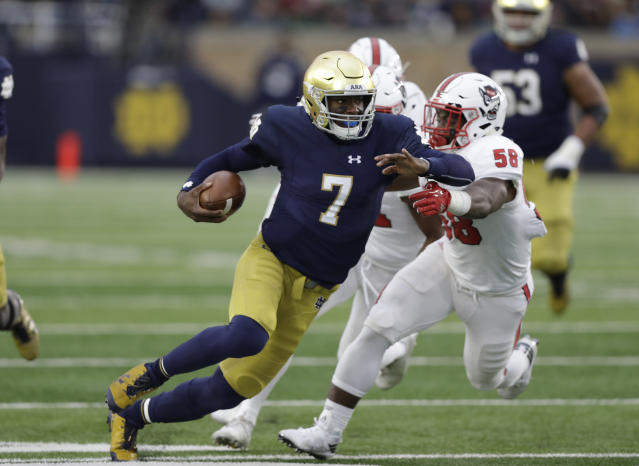 "Notre Dame quarterback <a class=""link rapid-noclick-resp"" href=""/ncaaf/players/257359/"" data-ylk=""slk:Brandon Wimbush"">Brandon Wimbush</a> is tackled by North Carolina State's Airius Moore during the first half of an NCAA college football game, Saturday, Oct. 28, 2017, in South Bend, Ind. (AP Photo/Darron Cummings)"
