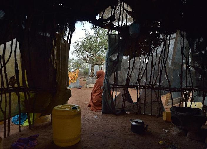 An elderly Somali woman sits outside a kitchen in a compound at Hagadera sector of the Dadaab refugee camp (AFP Photo/Tony Karumba)