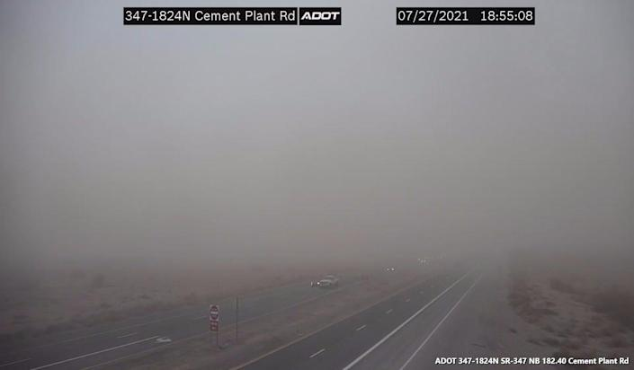 A dust storm near Casa Blanca Road and State Route 347 outside of Phoenix on Tuesday reduced visibility.