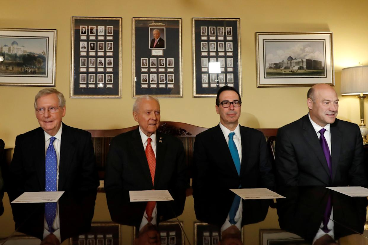 Senate Majority Leader Mitch McConnell, Sen. Orrin Hatch, Treasury Secretary Steve Mnuchin and National Economic Council Director Gary Cohn introduce the Republican tax reform plan at the Capitol on Nov. 9.  (Photo: Aaron Bernstein / Reuters)