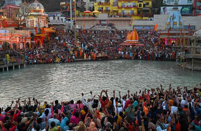 """<span class=""""caption"""">Hindu devotees attend evening prayers on the banks of the Ganges River during the religious Kumbh Mela festival in Haridwar, India.</span> <span class=""""attribution""""><a class=""""link rapid-noclick-resp"""" href=""""https://www.gettyimages.com/detail/news-photo/hindu-devotees-attend-evening-prayers-after-taking-a-holy-news-photo/1231647366?adppopup=true"""" rel=""""nofollow noopener"""" target=""""_blank"""" data-ylk=""""slk:Prakash Singh/AFP via Getty Images"""">Prakash Singh/AFP via Getty Images</a></span>"""