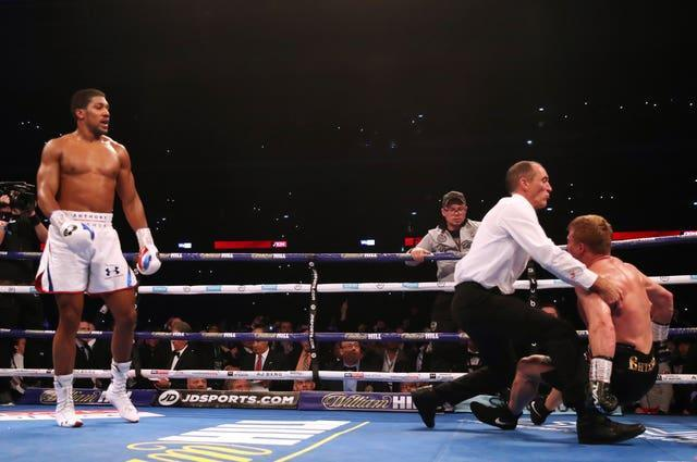 Anthony Joshua, left, floored Povetkin twice in the seventh round