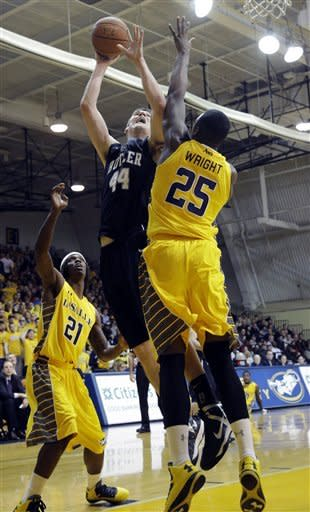 Butler's Andrew Smith, center, goes up for a shot between La Salle's Jerrell Wright, right, and Tyrone Garland during the first half of an NCAA college basketball game, Wednesday, Jan. 23, 2013, in Philadelphia. (AP Photo/Matt Slocum)