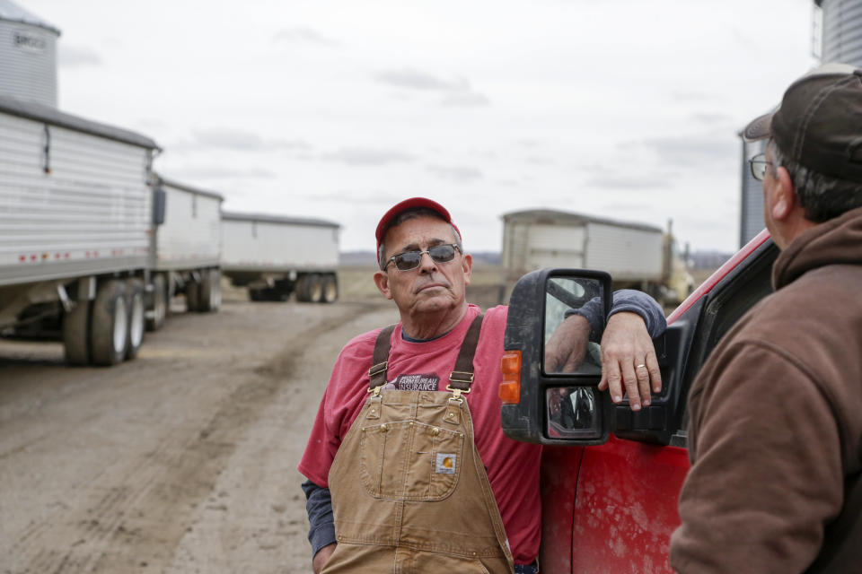 In this Tuesday, April 4, 2017, photo, Blake Hurst, a corn and soybean farmer and president of the Missouri Farm Bureau, left, talks with his brother Kevin Hurst on his farm in Westboro, Mo. U.S. President Donald Trump has vowed to redo the North American Free Trade Agreement, but NAFTA has widened access to Mexican and Canadian markets, boosting U.S. farm exports and benefiting many farmers. Hurst says NAFTA has been good for his business and worries that he'll lose out in a renegotiation. (AP Photo/Nati Harnik)