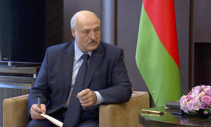 In this photo taken from video and released by Russian Presidential Press Service, Belarusian President Alexander Lukashenko talks with Russian President Vladimir Putin during their meeting in the Bocharov Ruchei residence in the Black Sea resort of Sochi, Russia, Monday, Sept. 14, 2020. Belarus' authoritarian president is visiting Russia in a bid to secure more loans and political support as demonstrations against the extension of his 26-year rule enter their sixth week. Alexander Lukashenko's talks Monday with Russian President Vladimir Putin in the Black Sea resort of Sochi come a day after an estimated 150,000 flooded the streets of the Belarusian capital, demanding Lukashenko's resignation. (Russian Presidential Press Service via AP)