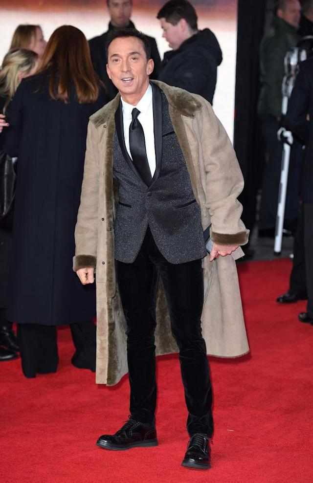 <p>The British television personality cozied up in a heavy taupe coat over a sparkling suit at the European premiere of <em>Star Wars: The Last Jedi</em>. (Photo: Getty Images) </p>
