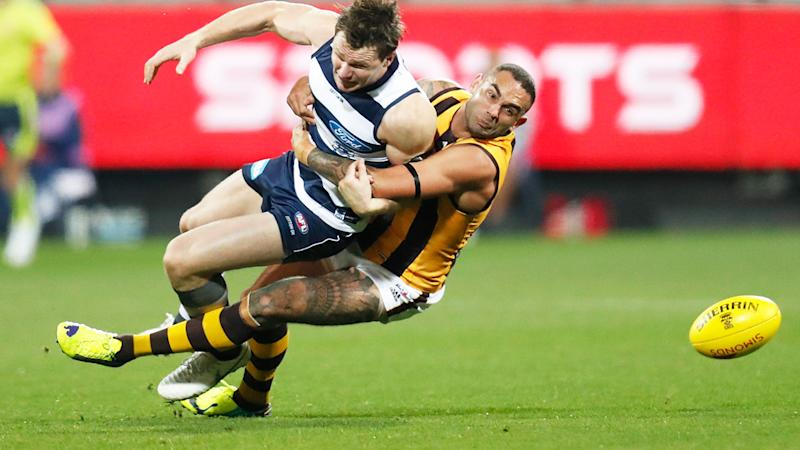 Hawthorn's Shaun Burgoyne is pictured tackling Geelong star Patrick Dangerfield.