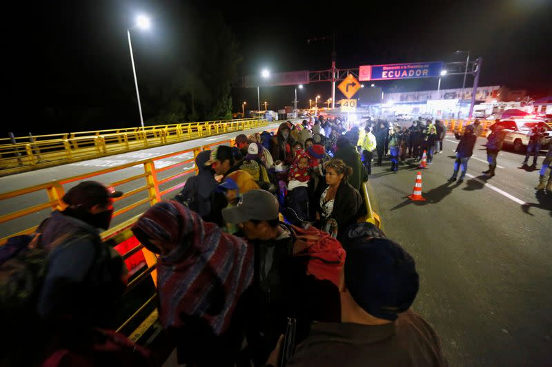 FILE PHOTO: Stranded migrants are pictured at Rumichaca International Bridge between Colombia and Ecuador, after Ecuador's government closed its borders to all foreign travelers due to the spread of the coronavirus disease (COVID-19), in Tulcan