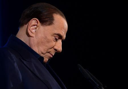 FILE PHOTO: Italy's former Prime Minister Silvio Berlusconi gestures as he speaks during a pre-election gathering in Milan, Italy February 25, 2018. REUTERS/Massimo Pinca/File Photo