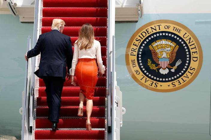 <p>President Donald Trump, with first lady Melania Trump, board Air Force One at Andrews Air Force Base, Md., Friday, May 19, 2017, prior to his departure on his first overseas trip. (Photo: Alex Brandon/AP) </p>