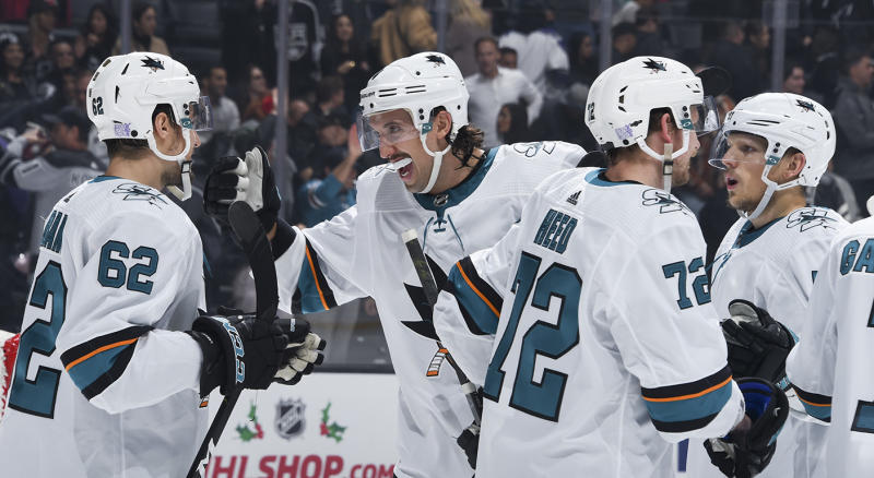 LOS ANGELES, CA - NOVEMBER 25: Brenden Dillon #4 of the San Jose Sharks celebrates San Jose Sharks win with teammates during overtime against the Los Angeles Kings at STAPLES Center on November 25, 2019 in Los Angeles, California. (Photo by Adam Pantozzi/NHLI via Getty Images)