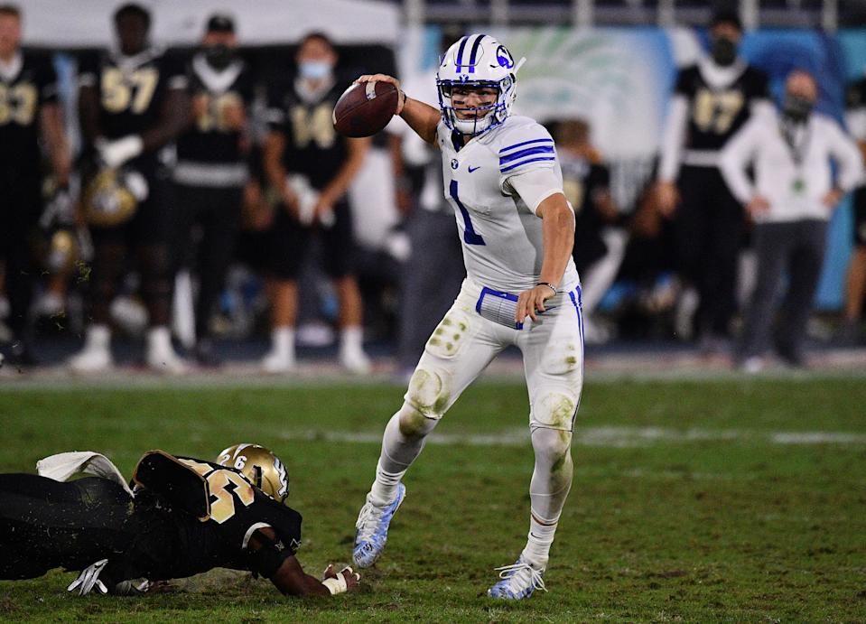 BOCA RATON, FLORIDA - DECEMBER 22: Zach Wilson #1 of the Brigham Young Cougars looks to pass against the Central Florida Knights at FAU Stadium on December 22, 2020 in Boca Raton, Florida. (Photo by Mark Brown/Getty Images)