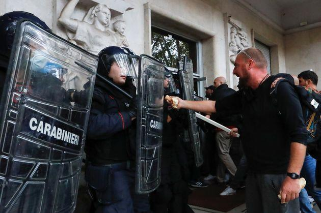 Demonstrators face off security personnel during a protest against the government's introduction of the
