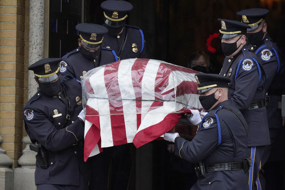 """Pallbearers from the U.S. Capitol Police carry the casket of William """"Billy"""" Evans from St. Stanislaus Kostka Church following a funeral Mass, Thursday, April 15, 2021, in Adams, Mass. Evans, a member of the U.S. Capitol Police, was killed on Friday, April 2, when a driver slammed his car into a checkpoint he was guarding at the Capitol. (AP Photo/Steven Senne)"""