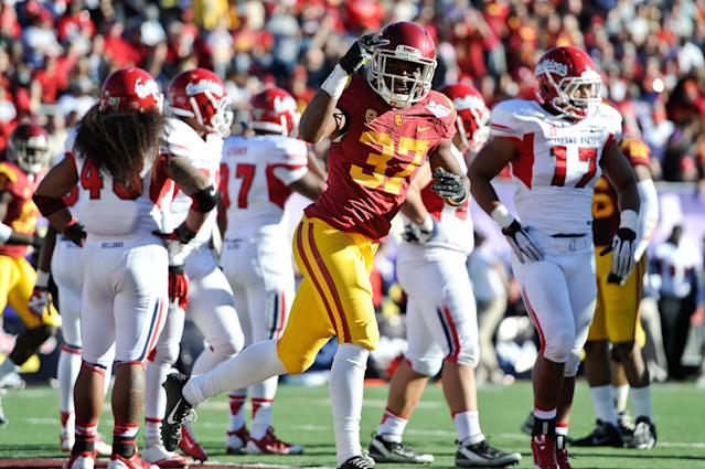 Southern California running back Javorius Allen (37) celebrates after his 24-yard touchdown run against Fresno State during the second quarter of the Royal Purple Bowl NCAA college football game, Saturday, Dec. 21, 2013, in Las Vegas. (AP Photo/David Cleveland)