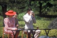 <p>On a joint tour to Japan, Prince Charles and Princess Diana sip tea as they visit Nijo Castle in Kyoto, Japan.</p>