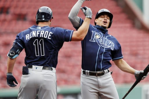 Tampa Bay Rays' Hunter Renfroe (11) celebrates his two-run home run with Willy Adames during the third inning of a baseball game against the Boston Red Sox, Thursday, Aug. 13, 2020, in Boston. (AP Photo/Michael Dwyer)