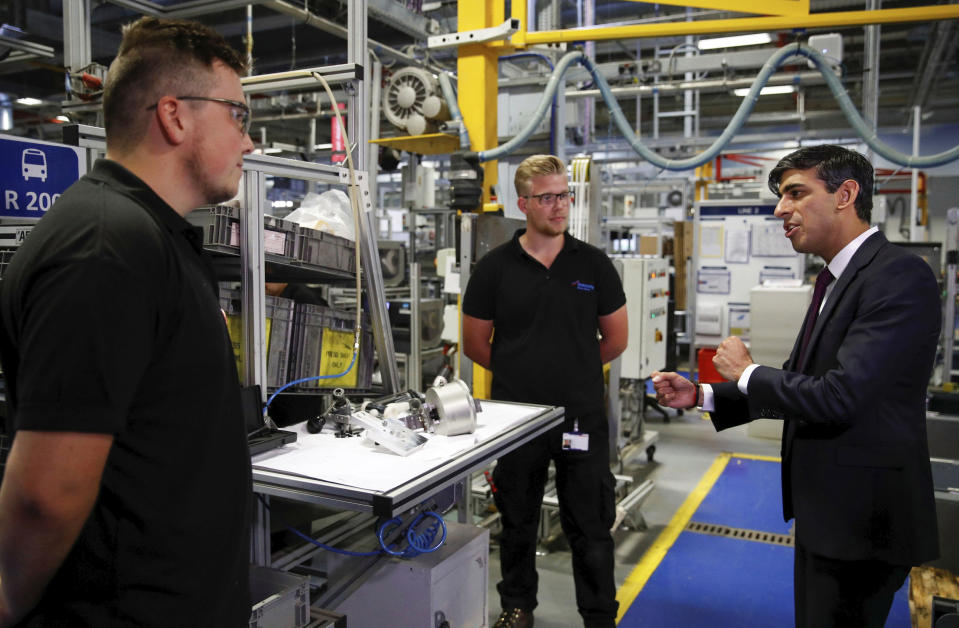 Britain's Chancellor of the Exchequer Rishi Sunak talks with employees during a visit to Worcester Bosch factory to promote the initiative, Plan for Jobs, in Worcester, England, Thursday July 9, 2020. (Phil Noble/Pool via AP)