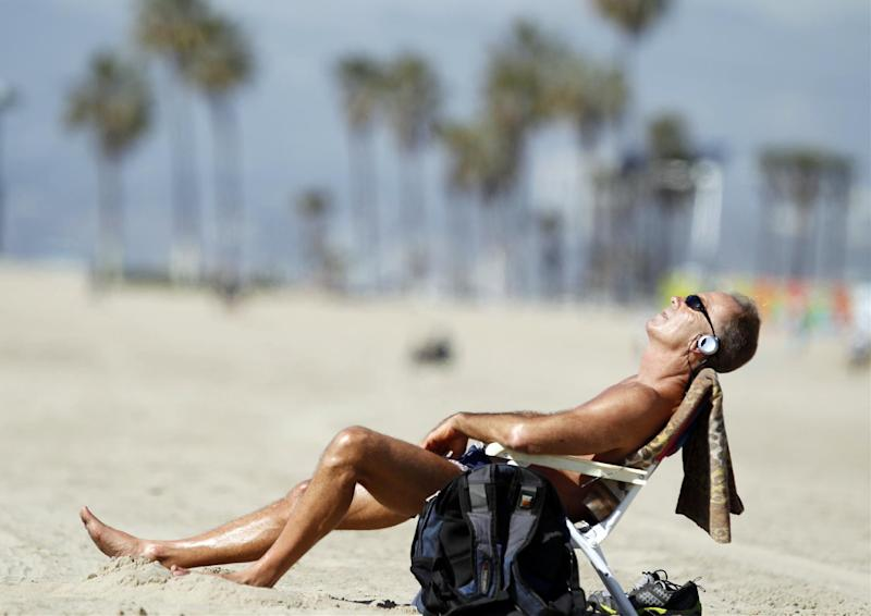 Venice Beach resident David Lomax enjoys the warm weather in the Venice Beach area of Los Angeles, Friday, Feb. 14, 2014. With much of the Northeast gripped by snow and ice storms, the Southwest is riding a heat wave that is setting record high temperatures and sent people to beaches and golf courses in droves Friday. (AP Photo/Damian Dovarganes)