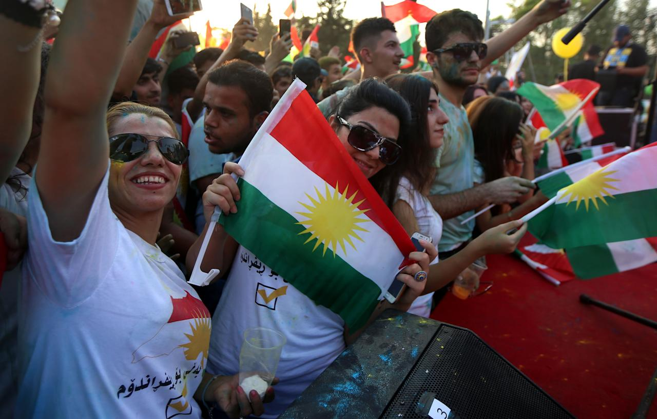 <p>Iraqi Kurds fly Kurdish flags during an event to urge people to vote in the upcoming independence referendum in Arbil, the capital of the autonomous Kurdish region of northern Iraq, Sept. 15, 2017. (Photo: Safin Hamed/AFP/Getty Images) </p>