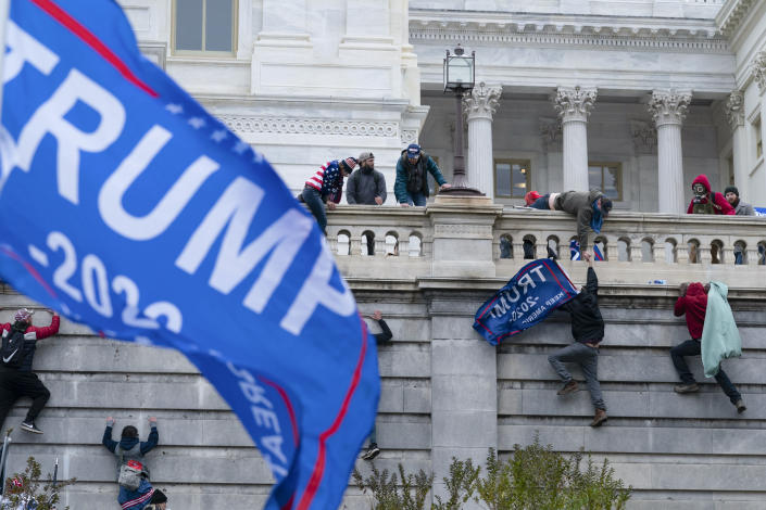 In this Jan. 6, 2021, photo, supporters loyal to then-President Donald Trump, try to break through a police barrier at the Capitol in Washington. Key figures in the Jan. 6 riot on U.S. Capitol spoke about their desire to overthrow the government, but to date, U.S prosecutors have charged no one with sedition. They could still add them. But prosecutors may be reluctant to bring them because of their legal complexity and the difficulty in securing convictions. (AP Photo/Jose Luis Magana)