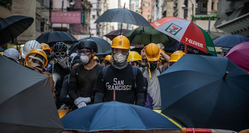 Hong Kong protesters in their trademark hard hats