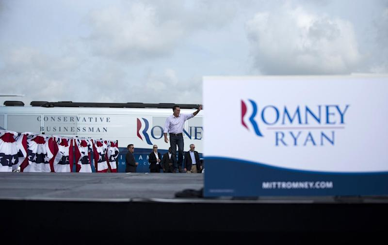 Republican presidential candidate, former Massachusetts Gov. Mitt Romney waves as he arrives for a campaign stop, Friday, Aug. 31, 2012, in Lakeland, Fla.  (AP Photo/Evan Vucci)