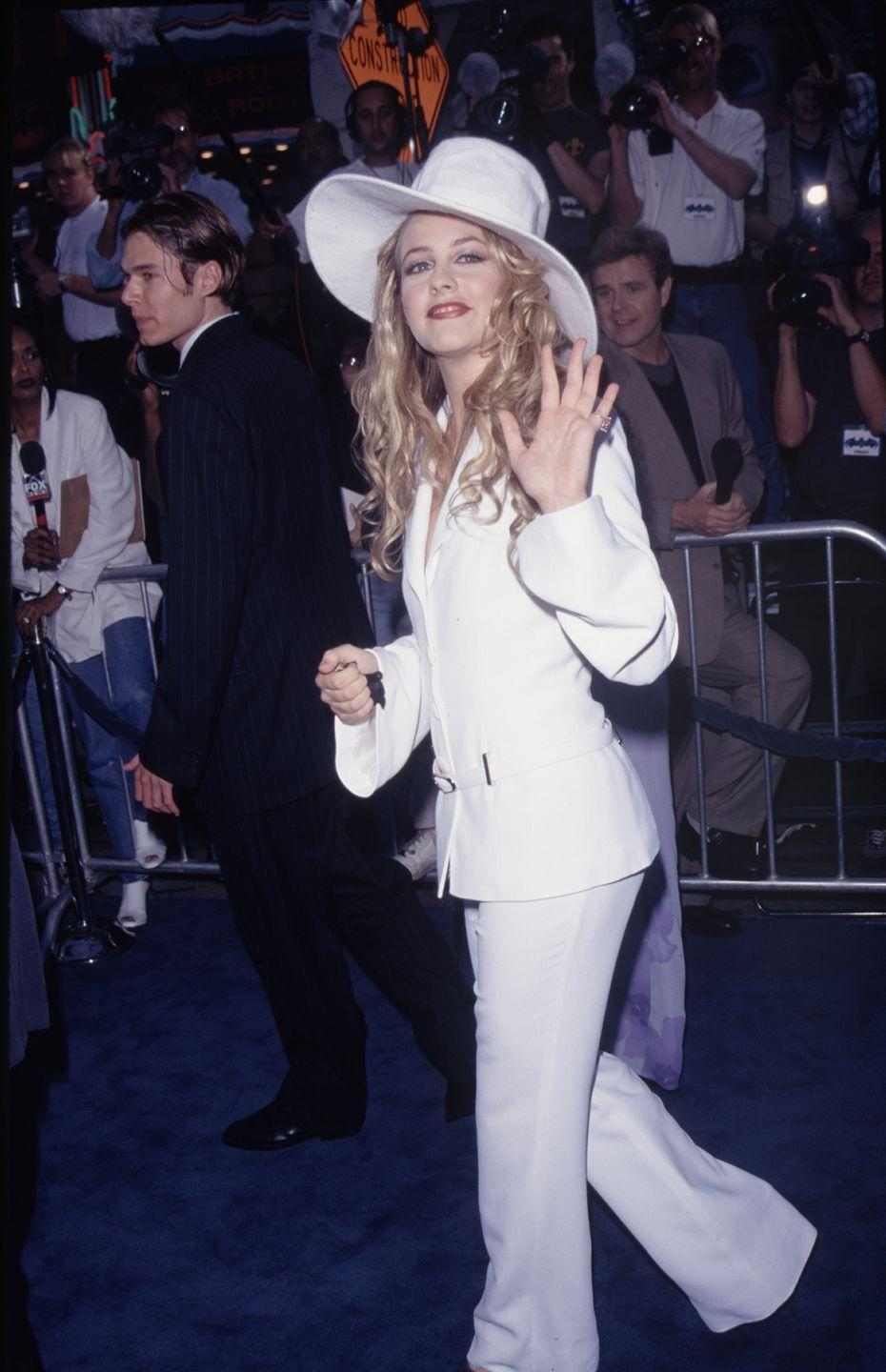 <p>The <em>Clueless</em> star wore an all-white ensemble with a hat Carmen Sandiego would totally wear to the premiere of <em>Batman and Robin</em>. Okay, so it's not an Alaïa, but it's definitely eye-catching. </p>