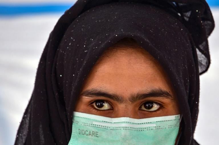 Smugglers refused to release 18-year-old Janu until her husband agreed to pay more; and eventually they abandoned her in Indonesia