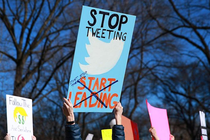 """<p>A protester hold up a sign addressing President Trump's """"abuse"""" of his Twitter account at a """"Not My President's Day"""" rally on Central Park West in New York, Feb. 20, 2017. (Gordon Donovan/Yahoo News) </p>"""
