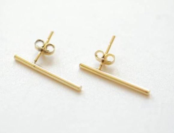 "This South Carolina-based jewelry shop designs small and minimalist earrings perfect for second or third piercings. Find these <a href=""https://fave.co/3gXDJPU"" target=""_blank"" rel=""noopener noreferrer"">gold bar earrings for $38</a> from <a href=""BrowneyedCapricorn"" target=""_blank"" rel=""noopener noreferrer"">Browneyed Capricorn on Etsy</a>."
