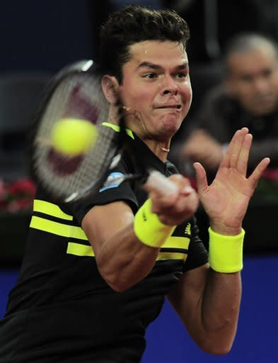 Milos Raonic returns the ball to Rafael Nadal during the semifinal of the Barcelona open tennis in Barcelona, Spain, Saturday, April 27, 2013. Nadal won 6-4, 6-0. (AP Photo/Manu Fernandez)