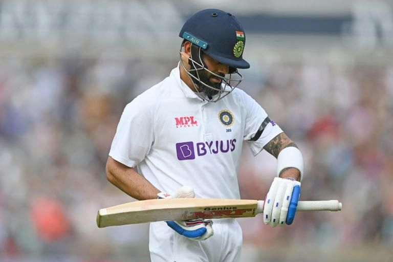 Fifty and out: India captain Virat Kohli walks back to the pavilion after being dismissed by Ollie Robinson on the first day of the fourth Test against England (AFP/DANIEL LEAL-OLIVAS)