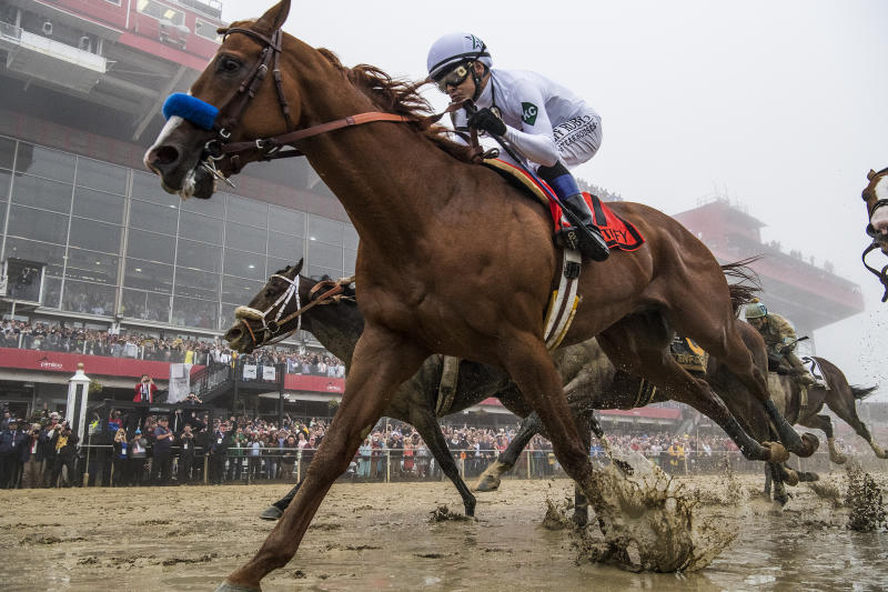 Justify wins Belmont Stakes to become Triple Crown champ