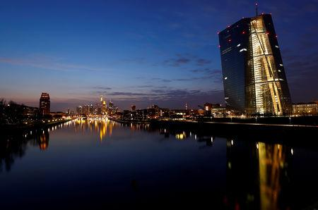 FILE PHOTO: The headquarters of the European Central Bank and the Frankfurt skyline with its financial district are photographed on early evening in Frankfurt