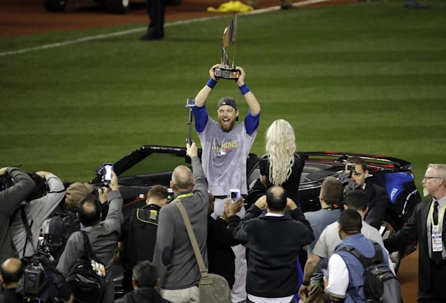 <p>Chicago Cubs' Ben Zobrist celebrates with his MVP trophy after Game 7 of the Major League Baseball World Series against the Cleveland Indians Thursday, Nov. 3, 2016, in Cleveland. The Cubs won 8-7 in 10 innings to win the series 4-3. (AP Photo/Gene J. Puskar) </p>
