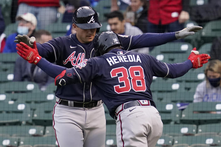 Atlanta Braves' Guillermo Heredia (38) celebrates with Atlanta Braves' Austin Riley after hitting a two-run home run during the first inning of a baseball game against the Chicago Cubs in Chicago, Sunday, April 18, 2021. (AP Photo/Nam Y. Huh)