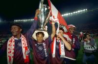FILE PHOTO: Ajax Amsterdam's Edgar Davids lifts the Champions League trophy aloft as he celebrates with Finidi George, Jari Litmanen and Nwankwo Kanu after they beat AC Milan in the final in Vienna.